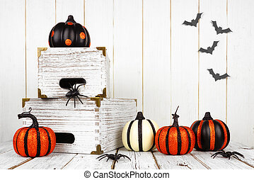 Halloween decor against a white wood background