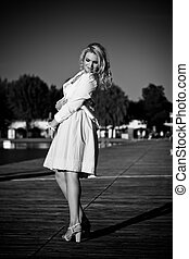 Black & White Photo of a Model standing on a wooden pier