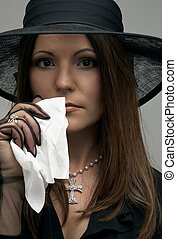 black widow - crying christian lady in black funeral dress