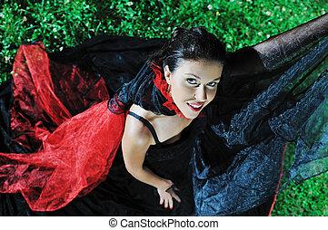 black widow - young beautiful bride in black wedding dress...