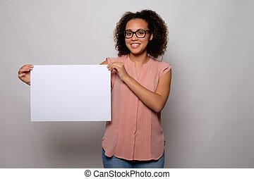 Black woman displaying white banner