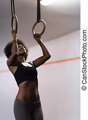 black woman doing dipping exercise - Fitness dip ring...
