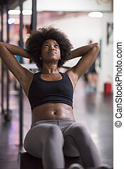 black woman doing sit ups at the gym - young fit african ...