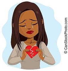 Black Woman Holding Broken Heart