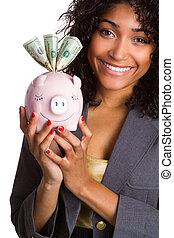 Black Woman Holding Piggy Bank