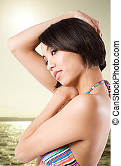 Black woman in bikini