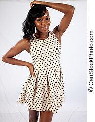 Black woman in dress standing