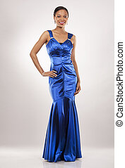 black woman in evening gown - beautiful woman wearing blue...