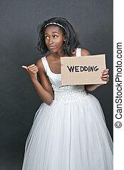 Black woman in wedding dress