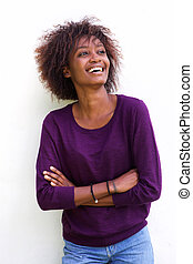 Black woman laughing against white background