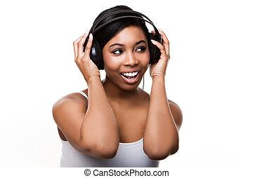 black woman listening to music