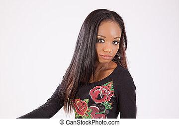 Black woman looking at the camera