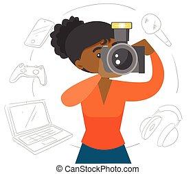 Black woman making a photo with modern camera