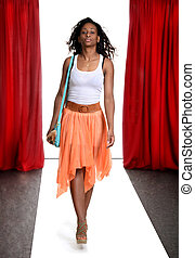 black woman on the catwalk
