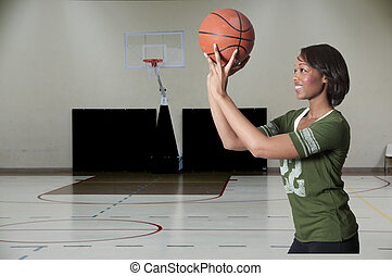 Black Woman Playing Basketball