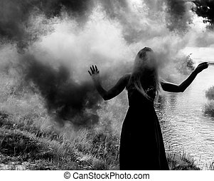 Black woman silhouette in cloud of a smoke