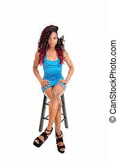 Black woman sitting on chair.