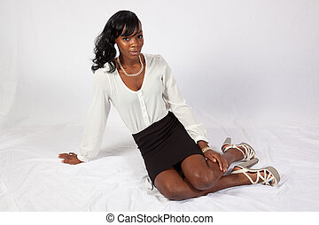 Black woman sitting on floor