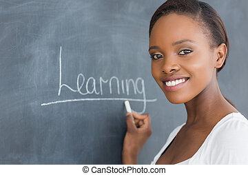 Black woman smiling while looking at camera