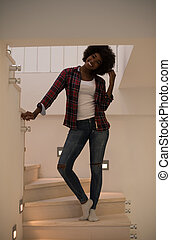 black woman standing on the stairs