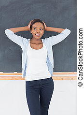 Black woman upset in a classroom