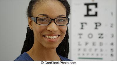 Black woman wearing glasses smiling