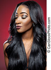 Black woman with long luxurious shiny hair
