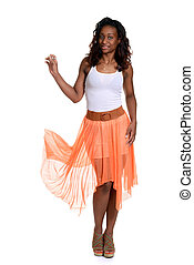 black woman with orange sheer dress