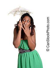 black woman with tiny umbrella fun