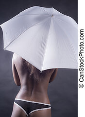 Black woman with umbrella from back