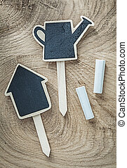 Black wooden chalkboard price sign tags on wood board agricultur