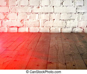 Black wooden floor and white brick wall background. Copy space with sun light halo. Toned
