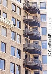 Black Wrought Iron Balconies on Old brick