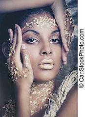 black young beauty portrait woman with  golden makeup studio
