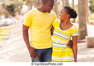 black young couple walking in the street - beautiful black...