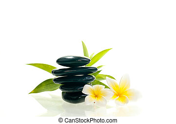 Black zen stone with two white flowers