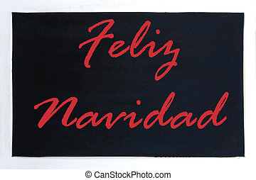 Blackboard advertising feliz navidad - In the picture we can...