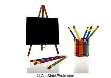 Blackboard and colourfull pencils - A blackboard on a tripod...