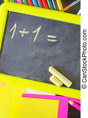 blackboard and school supplies