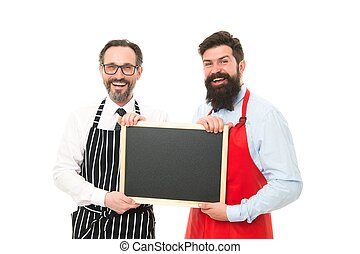blackboard. cafe and restaurant opening. bearded men with blackboard, copy space. menu planning. happy chef team in apron. catering business. welcome on blackboard board. partners celebrate start up