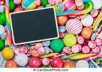 blackboard for the text on the background of lollipops and sweet