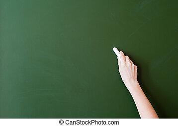 Blackboard - hand writing by chalk on a blackboard