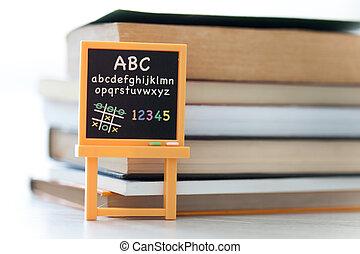 Blackboard in front of books
