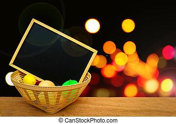 blackboard in toy basket with blur bokeh from traffic light background