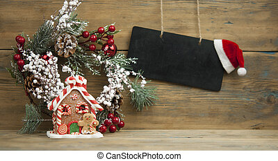blackboard mock up with Christmas gifts and rustic decorations on wooden background with space for your text