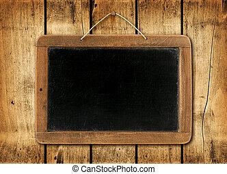Blackboard on a wood wall background
