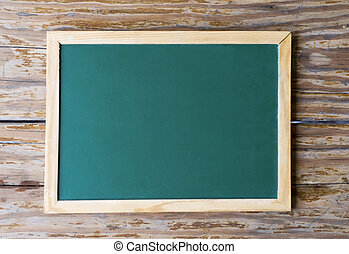 Blackboard on weathered wood