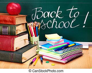blackboard., skolböcker, supplies.