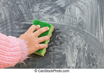 blackboard - A Erasing the blackboard. Close up