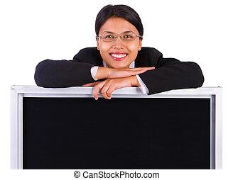 Blackboard to post message below smiling woman